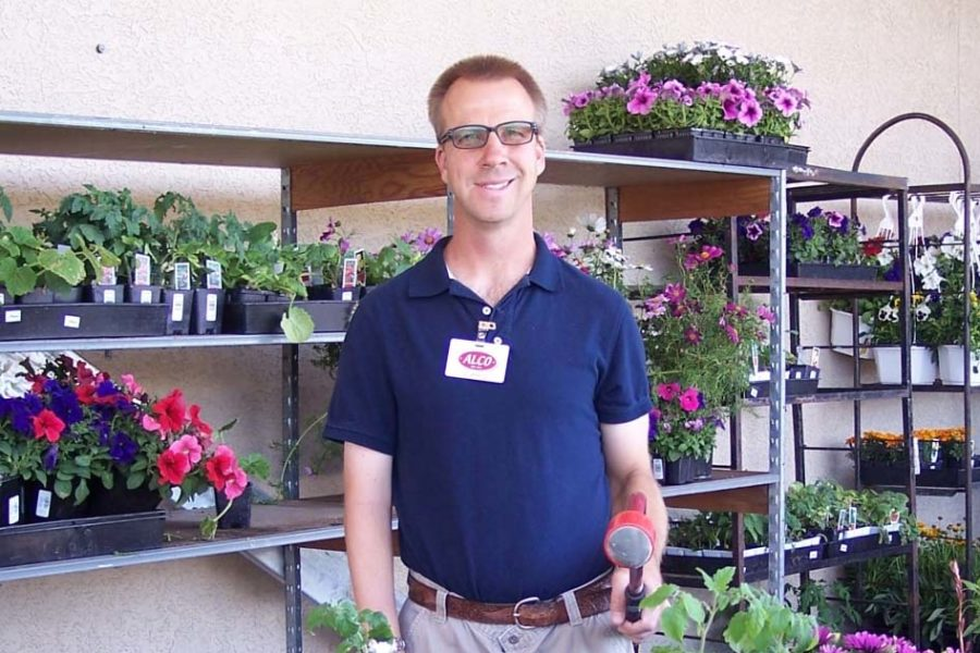 Man wearing glasses working at a flower shop