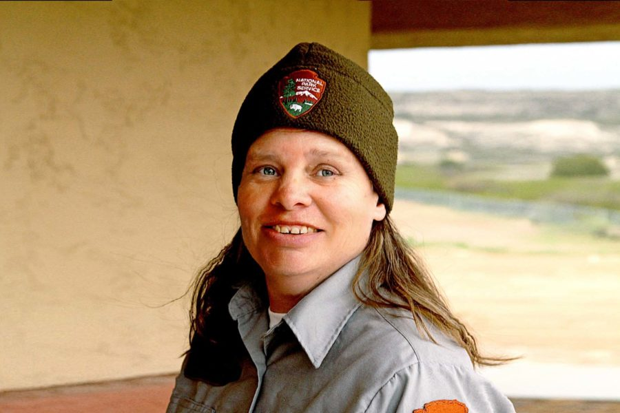Woman wearing national park service hat smiling